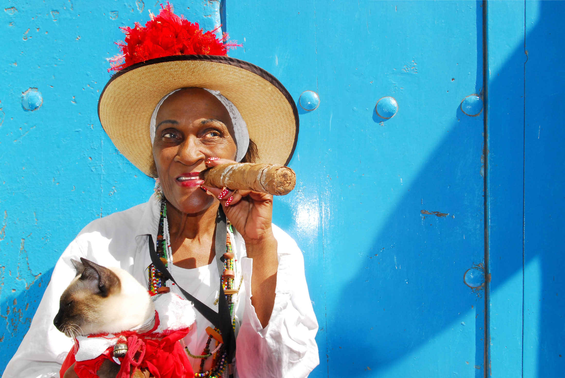 lady with a cuban cigar central america hero image