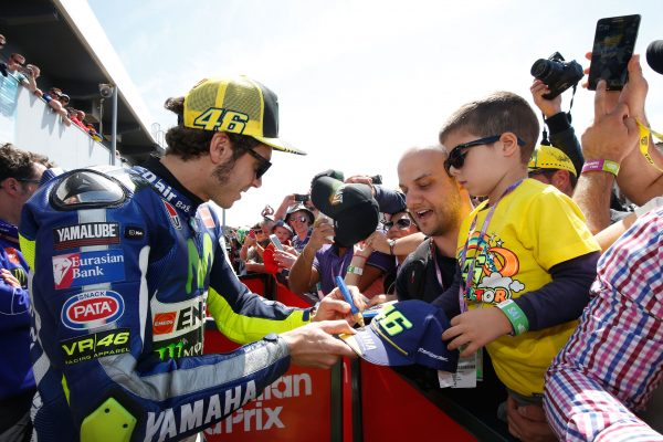 Signing autograph after announcing the winner - motorgp australia tickets